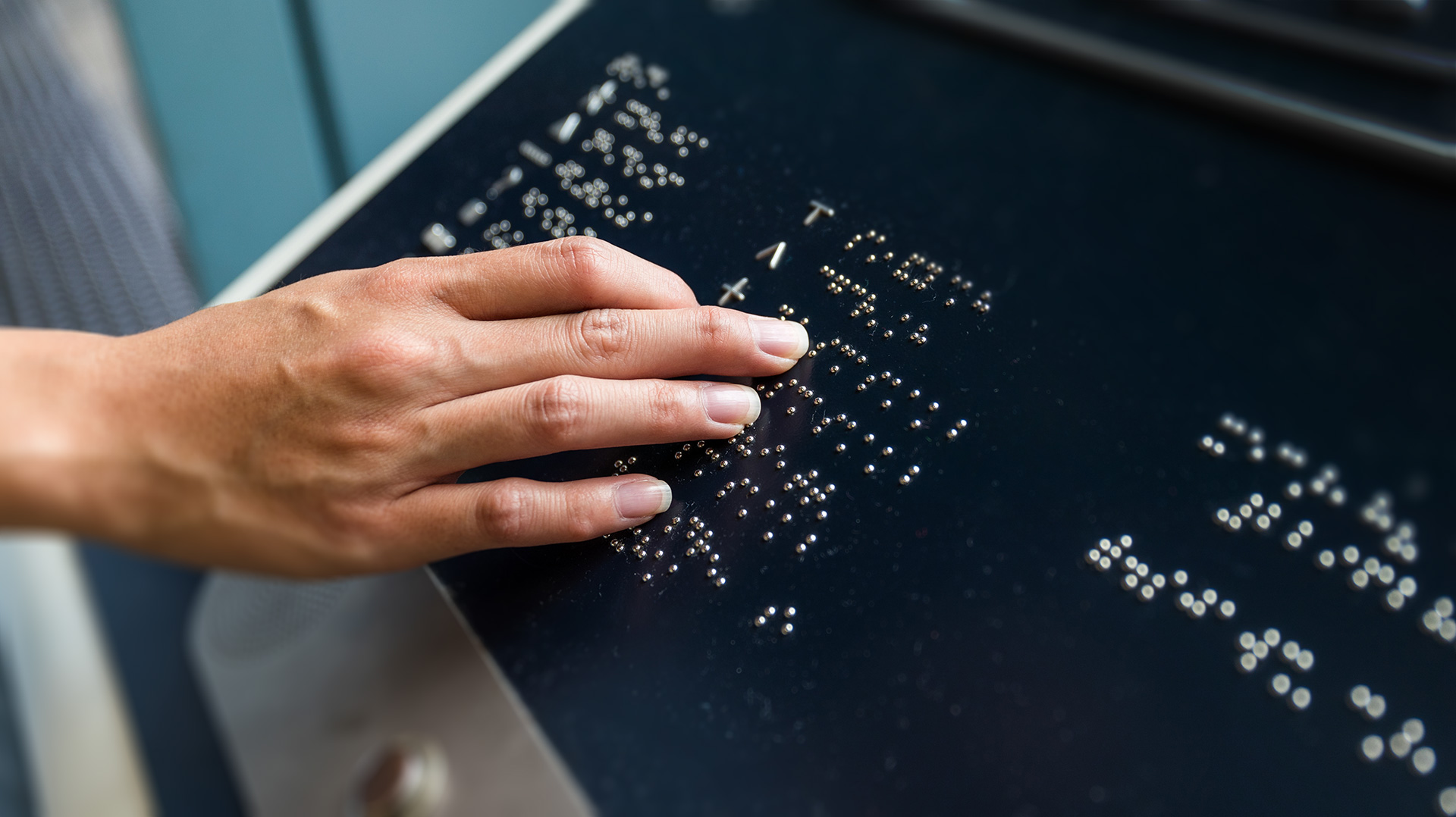 Hand touch on braille text panel